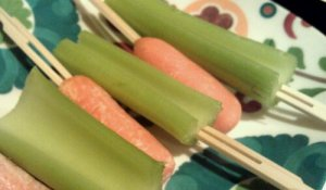 C is also for carrots and celery on fancy bamboo toothpicks and served on a pretty plate.