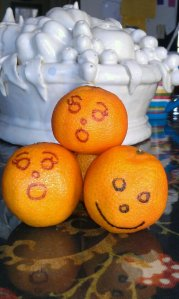 "O is for oranges with faces made of the letter ""O"".  My kids drew on the faces.  Fun."