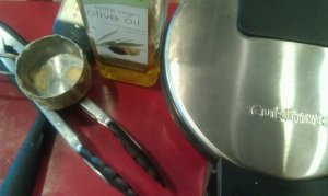 Olive oil, waffle iron, tongs, 1/4 cup measuring cup scoop