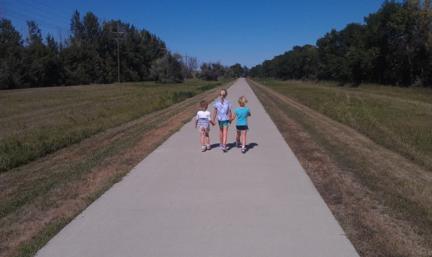 Three girls walking